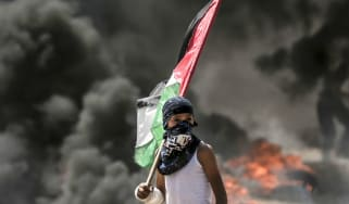 A Palestinian boy on the Gaza border during May's protests against US embassy move
