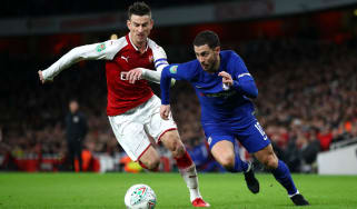 Chelsea forward Eden Hazard in action against Arsenal defender Laurent Koscielny