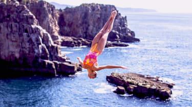 Helena Merten of Australia dives from a 92ft platform at the Red Bull Cliff Diving World Series