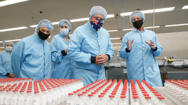 Australian Prime Minister Scott Morrison visits a facility producing the Oxford-AstraZeneca vaccine