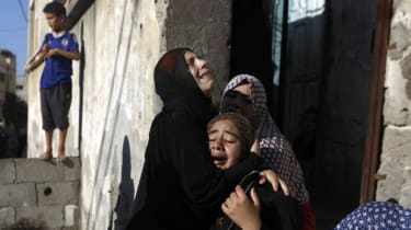Women mourn the deaths of four Palestinian boys
