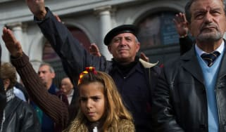 Girl performs fascist salute during rally marking anniversary of Francisco Franco's death