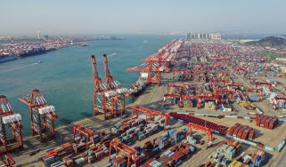 QINGDAO, CHINA - MAY 28: Aerial view of containers sitting stacked at Qingdao Port on May 28, 2019 in Qingdao, Shandong Province of China. (Photo by Han Jiajun/Visual China Group via Getty Im