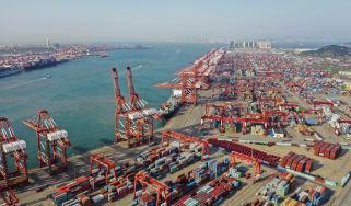 QINGDAO, CHINA - MAY 28: Aerial view of containers sitting stacked at Qingdao Port on May 28, 2019 in Qingdao, Shandong Province of China. (Photo by Han Jiajun/Visual China Group via Getty Im