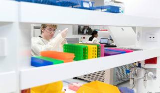 A scientist working on Pfizer vaccine development.