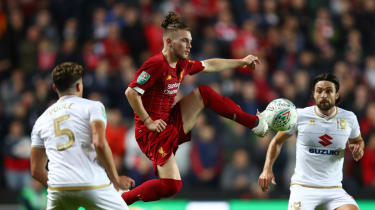 Harvey Elliott, 16, made Liverpool history by starting in the Carabao Cup win at MK Dons