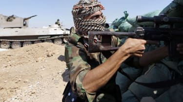 Iraqi Kurdish forces take position as they fight jihadist militants