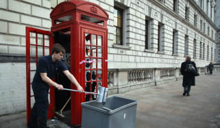 Red phone box smashed in London protest