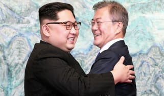 Kim Jong Un and Moon Jae-in embrace after signing the Panmunjom Declaration for Peace