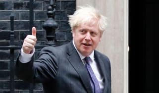 Boris Johnson give a thumbs-up gestures as he greets Abu Dhabi's Crown Prince Sheikh Mohammed bin Zayed al-Nahyan.