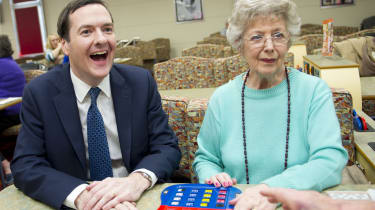 CARDIFF, UNITED KINGDOM - MARCH 25: Chancellor George Osborne laughs during a visit to Castle Bingo to see how it has been affected by the budget on March 25, 2014 in Cardiff, Wales. In the C