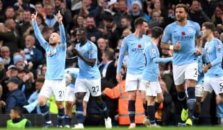 David Silva celebrates scoring Man City's opening goal against Man Utd