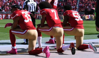 Eric Reid, Colin Kaepernick and Eli Harold kneel for the national anthem