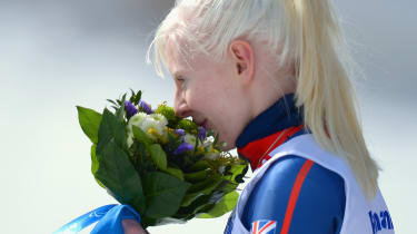 SOCHI, RUSSIA - MARCH 10:Gold medalist Kelly Gallagher of Great Britain smells her flowers during the flower ceremony for the Women's Super-G - Visually Impaired during day three of Sochi 201