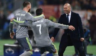 Sergio Ramos and Cristiano Ronaldo celebrate with Zinedine Zidane