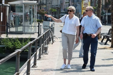 DESENZANO DEL GARDA, ITALY - JULY 29:British Prime Minister Theresa May, walks with her husband Philip whilst on vacation in Italy, July 29, 2018 in Desenzano del Garda, Italy.(Photo by Pier