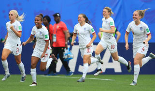 England players celebrate a goal against Cameroon in the World Cup round of 16