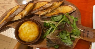 St Marcellin cheese served with bread, salad, mountain honey and truffle oil