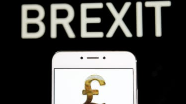 HONG KONG - 2019/04/20: In this photo illustration a Great Britain's currency Pound Sterling icon is seen on an Android mobile device with a Brexit message in the background. (Photo Illustrat