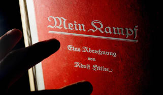 (FILES) - Picture taken on June 14, 2005 shows a man reading a signed copy of a first edition of Adolf Hitler's book Mein Kampf at Bloomsbury Auction House.Authorities in the southern German
