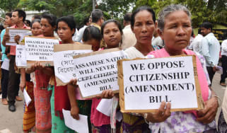 Anti-Bengali Indian demonstrators hold placards during a protest against the Citizenship (Amendment) Bill in 2016