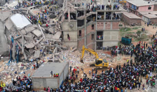 Bangladeshi volunteers and rescue workers are pictured at the scene after an eight-storey building collapsed in Savar, on the outskirts of Dhaka, on April 25, 2013. Survivors cried out to res