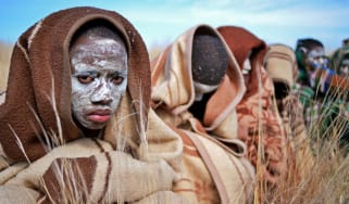 Boys from the Xhosa tribe who have undergone a circumcision ceremony sit near Qunu on June 30, 2013.