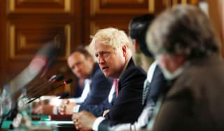 Boris Johnson chairs a socially distanced meeting of the cabinet.