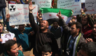 Syrian residents of Khan Sheikhun protest