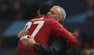 Manchester United midfielder Marouane Fellaini celebrates his winner with manager Jose Mourinho