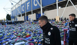 Leicester City striker Jamie Vardy looks at the floral tributes left to the victims of the helicopter crash