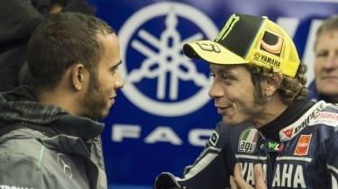 Formula 1 driver Lewis Hamilton speaks with MotoGP rider Valentino Rossi