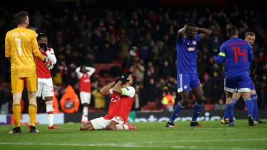 Arsenal captain Pierre-Emerick Aubameyang reacts after his late miss against Olympiacos