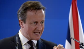 British Prime Minister David Cameron talks to the media at the end of a European Union Summit held at the EU Council building in Brussels on March 20, 2015.AFP PHOTO / THIERRY CHARLIER(Photo