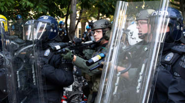 Riot police outside the White House in Washington DC