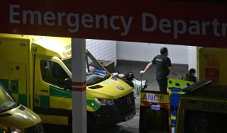 A paramedic wheels a patient into Guy's and St Thomas' Hospital, London.