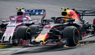 Red Bull driver Max Verstappen and Force India's Esteban Ocon clash at the F1 Brazilian GP