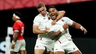 Manu Tuilagi celebrates his second try against Tonga with England team-mate George Ford