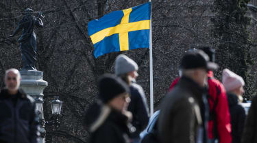 The Swedish flag is pictured on April 4, 2020 in Stockholm during the the new coronavirus COVID-19 pamdemic. (Photo by Jonathan NACKSTRAND / AFP) (Photo by JONATHAN NACKSTRAND/AFP via Getty I