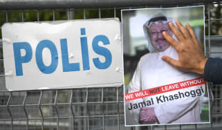 Protesters hold an image of Jamal Khashoggi outside the Saudi consulate in Istanbul