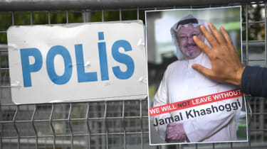 Protesters hold an image of Jamal Khashoggi outside the Saudi consulate in Istanbul