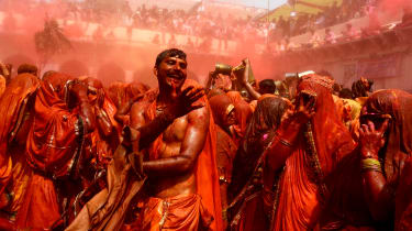 Indian revellers take part in the game of 'Huranga' at The Dauji Temple in Mathura, some 100kms south of New Delhi on March 18, 2014. 'Huranga' is a game played between men and women a day af