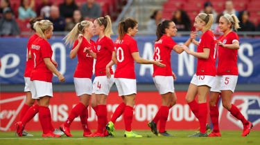 England women celebrate a goal against Japan in the SheBelieves Cup football