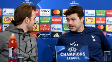 Tottenham manager Mauricio Pochettino (right) speaks with striker Harry Kane
