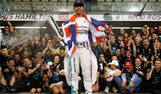 Lewis Hamilton celebrates after winning the Abu Dhabi Formula One Grand Prix at Yas Marina Circut