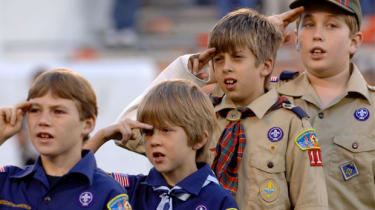 Scouts and cubs taking the scouting oath