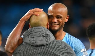 Manchester City captain Vincent Kompany is congratulated by manager Pep Guardiola
