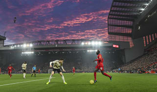 Liverpool take on Manchester United in a Premier League match.