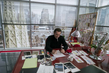 Ewan McGregor as Halston in his red-clad office in Olympic Tower, New York