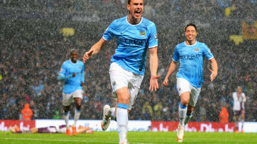 Manchester City's Edin Dzeko celebrates his opening goal against Aston Villa